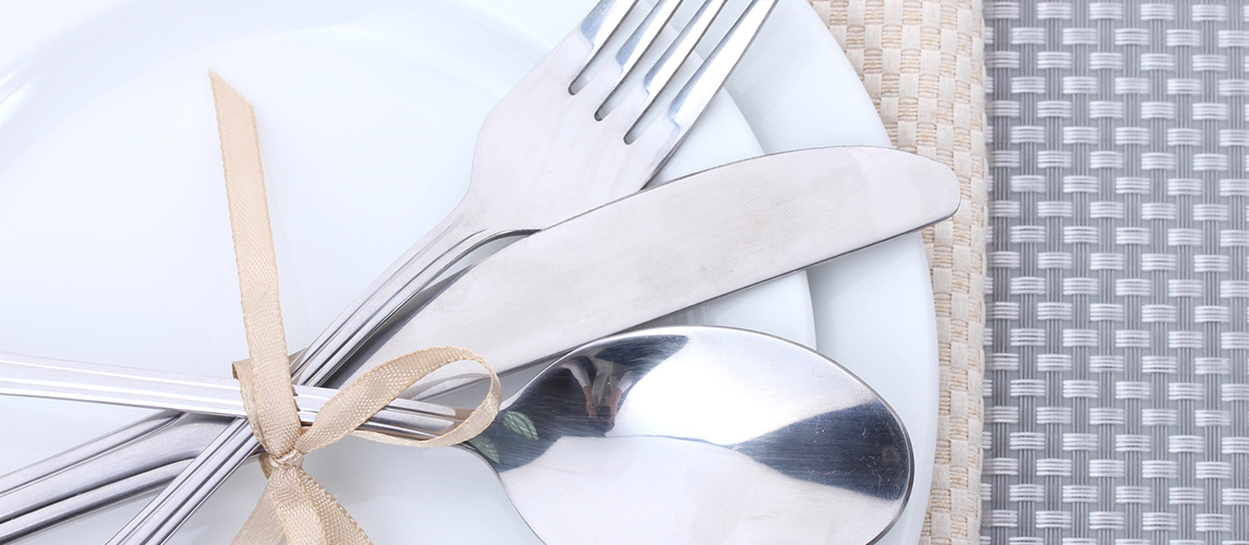 White empty plates with fork, spoon and knife