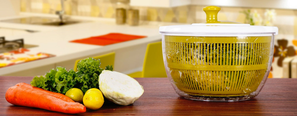 yellow salad spinner on the table