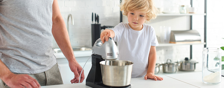 Man Standing Son While Using Mixer Kitchen