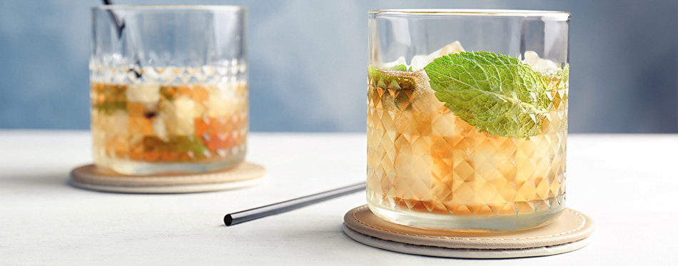 Delicious mint julep cocktail on table