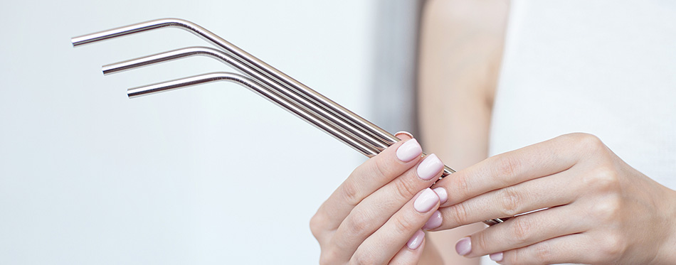 Girl is holding stainless steel straws