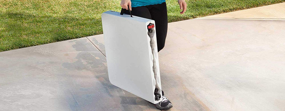 Woman holding folding table