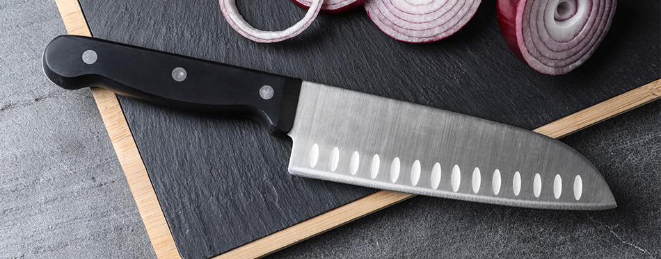 Board with sharp santoku knife