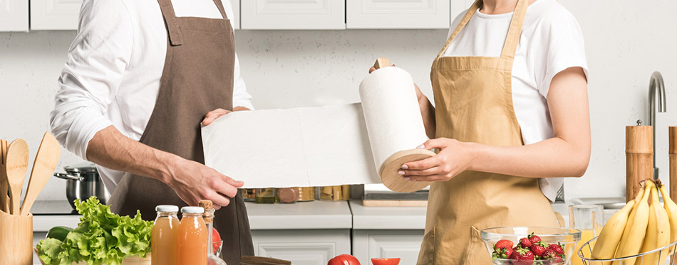 Woman and man holding paper towel in the kitchen