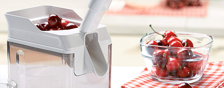 cherry pitter with cherries