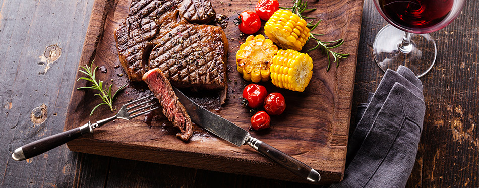 Grilled steak with corn and cherry tomatoes