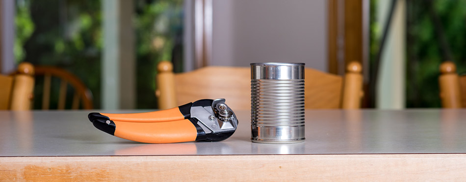 Metal can and opener on the counter top
