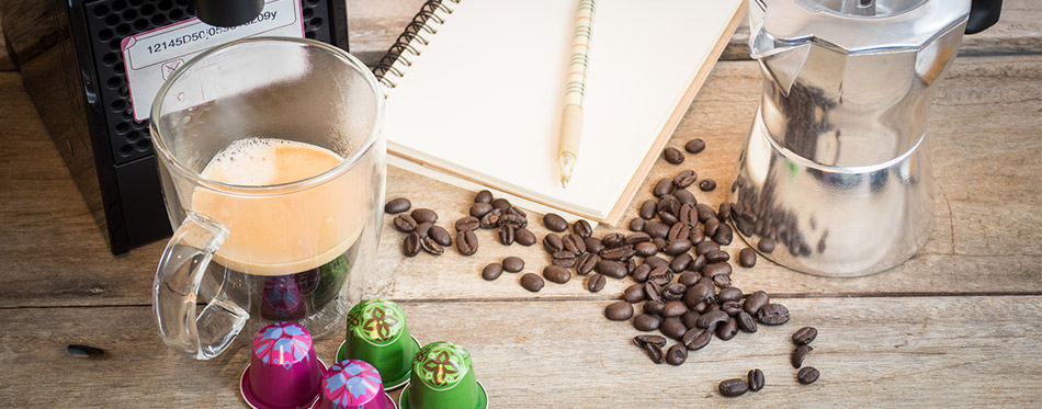 Nespresso capsule, coffee maker and coffee beans