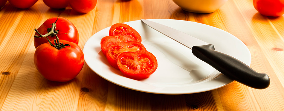 Tomato and Knife on the table