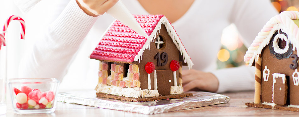 Woman making gingerbread houses
