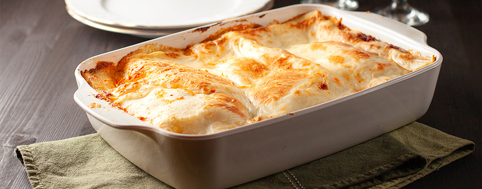 Homemade lasagna in a white bowl