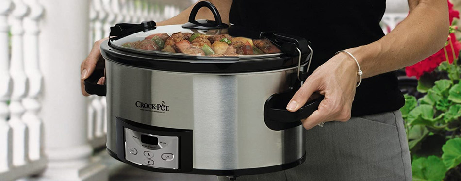 Woman holding a slow cooker
