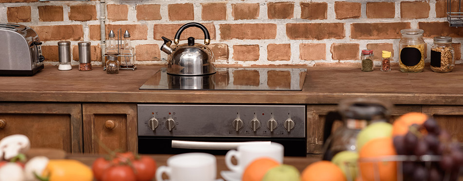 Electric stove and kettle in modern kitchen